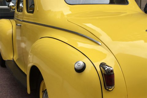 yellow antique chrysler back